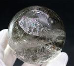 内部から虹色の閃光を放つ!カルサイト(Calcite)の大きな球体結晶。その名もレインボーカルサイト!